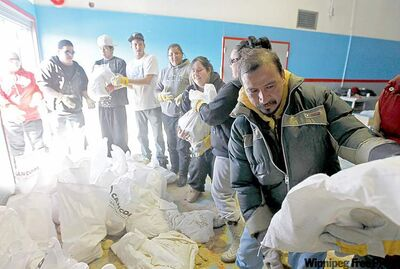 Volunteers distribute sandbags in the old school at Peguis, which has been converted into a flood command centre.