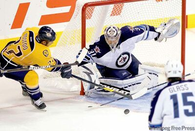 WINNIPEG OUT - Winnipeg Jets' goalie, Ondrej Pavelec stops Nashville Predators' Jordin Tootoo during the third period at MTS Centre, September 30th, 2011. (TREVOR HAGAN/WINNIPEG FREE PRESS)