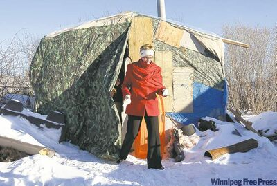 Adrian Wyld / THE CANADIAN PRESS On Tuesday, NDP Leader Nycole Turmel steps out of one of the dwellings on the Attawapiskat reserve.