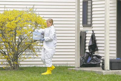 Matthew Healey / Boston Herald / MCTA federal crime-scene investigator examines an apartment on Monday that belonged to two men  who allegedly had ties to Dzhokhar Tsarnaev.
