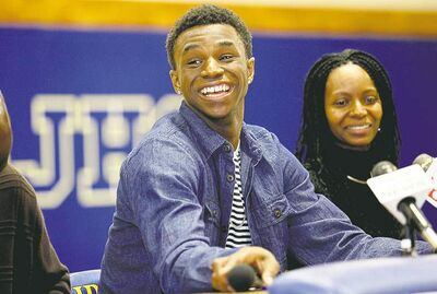 Sholten Singer / the associated pressAndrew Wiggins smiles along side his mother Marita Payne-Wiggins at his signing ceremony Tuesday.