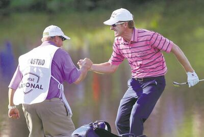 Patrick Semansky / the associated pressRoberto Castro celebrates with his caddie Rusty Stark after saving par on 18 with a chip-in from 80 feet. He shares the lead in the AT&T National after an even-par 71.