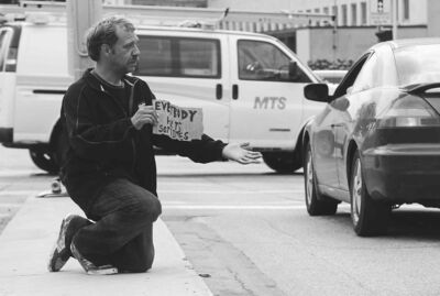 Kevin LeBlanc is on the corner of Osborne Street North and Broadway asking motorists for money.