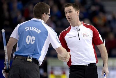 Newfoundland and Labrador skip Brad Gushue, right, shakes hands with Quebec second Eric Sylvain following Friday afternoon's game. Gushue and his squad won 5-4.
