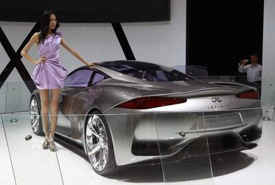 A model poses by the Infiniti Emerg-E concept during the Beijing International Automotive Exhibition.