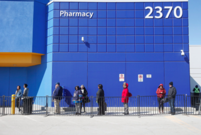 Shoppers at the Walmart on McPhillips Street line up outside the store on Sunday, to keep the number of shoppers inside at a level in which people can keep their distance from one another. John Woods / Winnipeg Free Press
