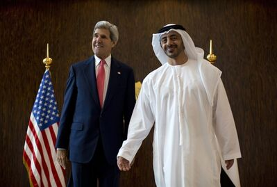 U.S. Secretary of State John Kerry, left, and United Arab Emirates Foreign Minister Abdullah bin Zayed Al-Nahyan pose for photographers at the foreign ministry in Abu Dhabi, Monday, Nov. 11, 2013. (AP Photo/Jason Reed, Pool)