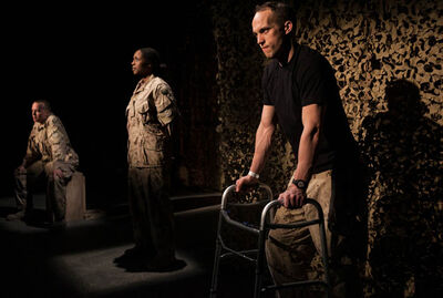 The Tarragon Theatre and Prairie Theatre Exchange joint production of This Is War. John Cleland as Sergeant Hughes (background) Lisa Berry as Master Corporal Tanya Young and Ian Lake as Private Jonny Henderson.