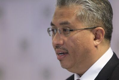 Managing Director of Khazanah Nasional, Berhad Azman Mokthar speaks during a press conference in Kuala Lumpur, Malaysia, Friday, Aug. 29, 2014. Khazanah Nasional, the state investment company that owns 69 percent of Malaysia Airline, said the overhaul includes the establishment of a new company that will take over the existing Malaysia Airlines business and its reduced staff. The airlines will cut 6,000 workers as part of an overhaul announced Friday to revive its damaged brand after being hit by double passenger jet disasters. (AP Photo/Lai Seng Sin)