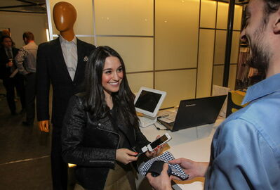 Stefanie Baglieri, manager at Eph Apparel on Fort Street, uses an original Square scanner to ring up a sale. A new version is a stand that holds an iPad, which can be fastened to a tabletop.