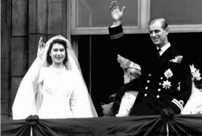 Nov. 20, 1947: Britain's Princess Elizabeth and her husband Philip, the Duke of Edinburgh, wave from the balcony of London's Buckingham Palace  following their wedding at Westminster Abbey.