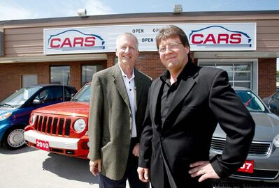BORIS MINKEVICH / WINNIPEG FREE PRESS Boyd Autobody founder Terry Smith (left) and partner Mark Bychkowsky hope to build brand recognition with their new used-car venture.