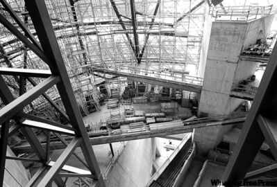While work proceeds to complete the museum's outer structure, a cash shortfall will delay completion inside until at least 2014.