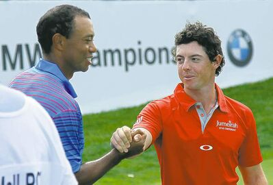 Charles Rex Arbogast / the associated pressTiger Woods (left) and Rory McIlroy after completing Thursday�s first round.