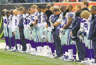Dallas players during a moment of silence honouring teammate Jerry Brown.
