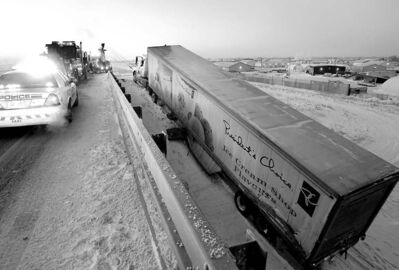 WAYNE GLOWACKI / WINNIPEG FREE PRESS A semi-trailer is towed after it slid off the East Perimeter Highway onto a rail track and was hit by a train.