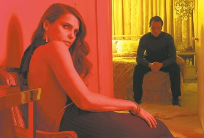 Keri Russell, left, as Elizabeth Jennings, Matthew Rhys as Phillip Jennings in FX's smart espionage drama, The Americans.