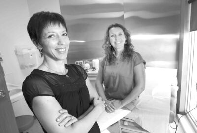 Annabelle Reimer, the lead nurse practitioner, and Frankie Scribe, (left in black) the manager of Winnipeg Quick Care clinics.