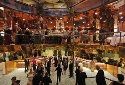 Passengers walk around the MS Balmoral Titanic memorial cruise ship, prior to the gala dinner in the Atlantic Ocean, Tuesday, April 10, 2012. Nearly 100 years after the Titanic went down, the cruise with the same number of passengers aboard is setting sail to retrace the ship's voyage, including a visit to the location where it sank. The Titanic Memorial Cruise departed Sunday, April 8, from Southampton, England, where the Titanic left on its maiden voyage and the 12-night cruise will commemorate the 100th anniversary of the sinking of the White Star liner. With some 1,300 passengers aboard, the MS Balmoral will follow the same route as the Titanic and organizers are trying to recreate the onboard experience minus the disaster from the food to a band playing music from that era. (AP Photo/Lefteris Pitarakis)