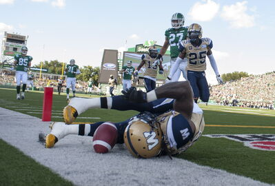 Winnipeg Blue Bombers defensive back Troy Stoudermire dives for a touchdown on a Saskatchewan Roughriders kick return during the 3rd quarter of CFL action in Regina, Sask., Aug. 31, 2014.