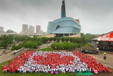 Winnipeggers participate in the 2014 living flag at the Forks.