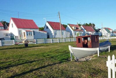 A children's playground is seen in front of old houses, some dating from the 1800s in Stanley, Falkland Islands.