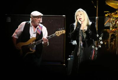 John McVie accompanies Stevie Nicks.