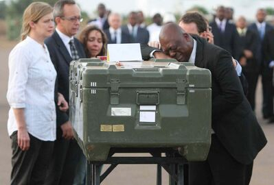 Serge Daniel (right) Mali correspondent for Radio France Internationale weeping as he pays his last respects at the coffin of one of the two French journalists kidnapped and executed in northern Mali. At least 70 journalists were killed on the job around the world in 2013, including 29 who died covering the civil war in Syria and 10 slain in Iraq, according to the Committee to Protect Journalists.