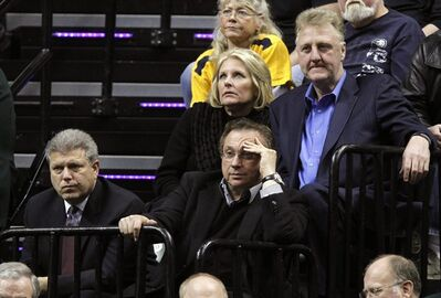 FILE - In this Jan. 26, 2011, file photo, Indiana Pacers general manager David Morway, bottom left, president of basketball operations Larry Bird, top right, his wife Dinah Mattingly and team owner Herb Simon, center, watch an NBA basketball game between the Pacers and the Orlando Magic in Indianapolis. Morway, who was hired by the Pacers in 1999 and had been GM since 2008, has resigned as general manager of the Pacers amid reports that Larry Bird is on the way out, too, according to the Indianapolis Star, Tuesday, June 26, 2012. (AP Photo/Michael Conroy, File)