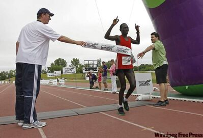 Philip Samoei, the winner of this year's Manitoba Marathon, crosses the finish line at the University of Manitoba Sunday morning.