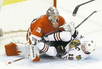 Detroit Red Wings goalie Jimmy Howard stops Blackhawks captain Jonathan Toews yet again Thursday night.