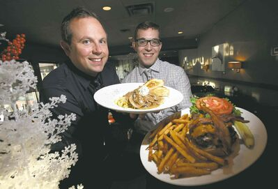 Phil Hossack / Winnipeg Free Press Oakwood Caf�� partners Peter Paley (left) and Alix Loiselle hold their favourite dishes, beef stroganoff and the Oakwood burger, respectively. A breakfast/lunch/dinner nook in trendy south Osborne, the Oakwood was one of the first restaurants in the area.