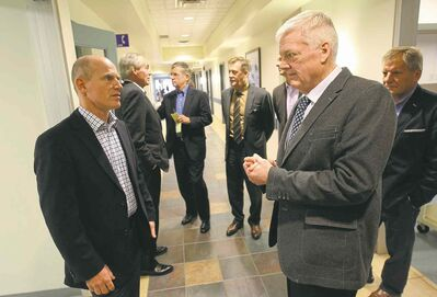 Dr. Wayne Hildahl (right) chats with Dr. Robert Litchfield during a tour of the Pan Am Clinic Friday.