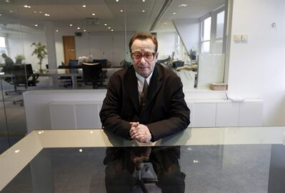 "Lord Maurice Saatchi poses for photos at his office in central London, Monday, Feb. 4, 2013. Saatchi's wife, best-selling Irish novelist Josephine Hart, died from ovarian cancer in 2011, and he describes his wife's cancer treatment as ""medieval"", and is proposing a parliamentary bill to legalize the ability of doctors to use experimental therapies even if there is no proof they work. Saatchi acknowledges his bill, aimed at encouraging new therapies and speeding up access to new drugs, is driven by grief for his wife, and that the bill may not make it into law, but he has wide support from numerous members of parliament and he remains hopeful about giving new opportunities to doctors and their patients.(AP Photo/Lefteris Pitarakis)"