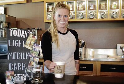 June 25, 2015 - Kyla Fletcher of Mountain Bean Coffee (2001 Henderson Hwy.) offers up a cup of The Grizz, one of the Fair Trade blends available at the local coffee hot spot. (SHELDON BIRNIE/CANSTAR COMMUNITY NEWS/THE HERALD)