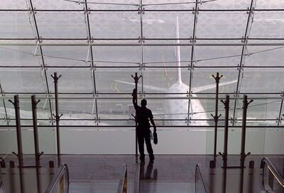 In this Feb. 10, 2013, photo a laborer cleans a window at the new Concourse A of the Dubai airport in Dubai, United Arab Emirates. THE CANADIAN PRESS/AP, Kamran Jebreili