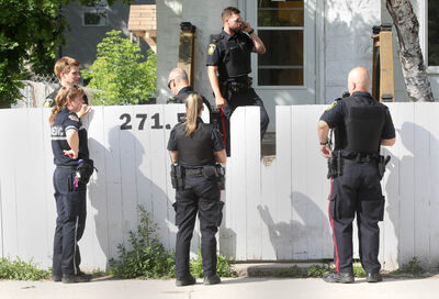 Police are gathering at a home on Selkirk Avenue between Charles and Main Street Friday evening. They appear to be guarding a crime scene.