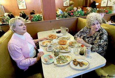 Longtime Shanghai customers Donna Finkelman (left) and Sharon Freed enjoy a last meal there Sunday.