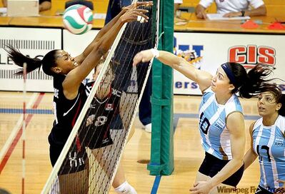 Colin Corneau / Brandon SunTeam Canada�s Nadine Alphonse (left) attempts to block a spike by Argentina�s Sosa Emilce during action in Brandon on Monday. After the match, Elizabeth Cordonier (below) got some good news.