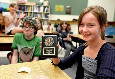 Grade 6 Windsor School student Sydney is all smiles after receiving the  Marion and Dean Finlay Citizenship Award on their last day of school.