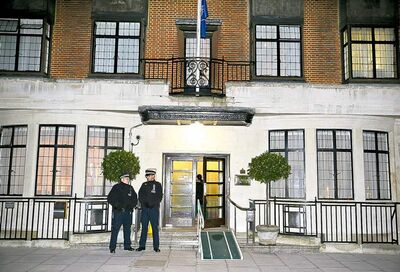 Two policemen stand guard outside King Edward VII hospital in central London on Friday. The hospital on Friday reported  the death of a nurse who relayed a prank telephone call made to elicit information about the Duchess of Cambridge.