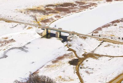 BORIS MINKEVICH / WINNIPEG FREE PRESSThis aerial photo of the floodway gates along the Red River in St. Norbert, taken Wednesday, shows the huge amount of snow awaiting the spring melt.