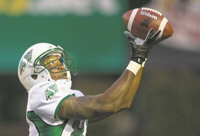 Geoff Robins / the canadian press Geroy Simon collects the Roughriders� first touchdown of three against the Hamilton Tiger-Cats Saturday at Guelph, Ont.