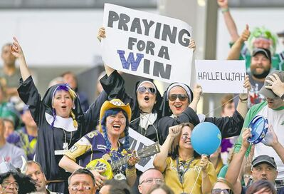 Winnipeg Blue Bombers fans celebrate their club's win in the Banjo Bowl at Investors Group Field Sunday.