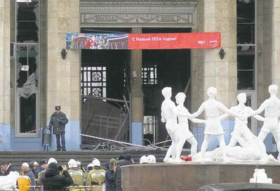 A police officer guards a taped-off main entrance to the Volgograd railway station that was hit by an explosion in Volgograd, Russia, Sunday.