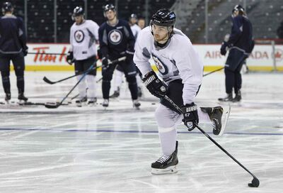 Winnipeg Jets' Michael Frolik (67) takes a shot during a very short practice Sunday.