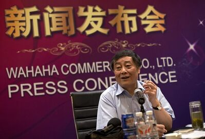 In this Wednesday, July 17, 2013 file photo, Zong Qinghou, chairman of food and beverage giant Wahaha Group, smokes as he speaks to the journalists during a news conference in Beijing, China. Chinese police detained a laborer who approached Zong, China's second-richest man, to ask for a job and then attacked and injured him when he denied the request, state media reported Wednesday, Sept. 18. (AP Photo/Andy Wong, File)