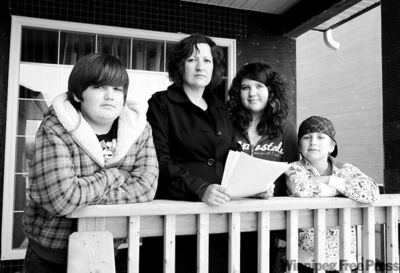 BORIS MINKEVICH / WINNIPEG FREE PRESS Homebuyer Carol Patterson, with (from left) Austin,11, Renee, 12, and Cole, 7, was floored by $4,650 bill.