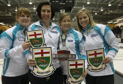 Dawn Askin, Jill Officer, Kaitlyn Lawes, and Jennifer Jones celebrate their championship at the 2012 Manitoba Scotties Tournament of Hearts in Portage la Prairie Sunday. Jones' foursome defeated Morden's Chelsea Carey 6-5. Jones and her team will represent Manitoba at the 2012 Scotties final in Red Deer, Alta., Feb. 18-26.