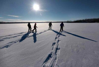 Members of the 23rd Brandon Scouting Group blaze a trail across snow-covered Williams Lake during a family fun day trip to Turtle Mountain Provincial Park early this winter.